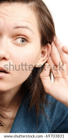 Beautiful woman listening a secret - stock photo