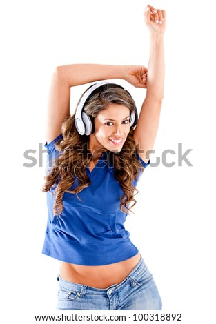 Beautiful woman listening to music - isolated over a white background - stock photo