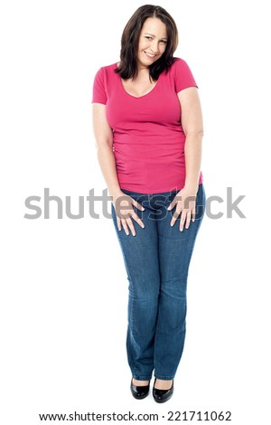 Beautiful woman looking at camera with adorable smile - stock photo