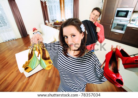 Beautiful woman looking at her clothes at home. - stock photo