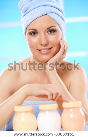 beautiful woman looking at herself in the mirro - stock photo