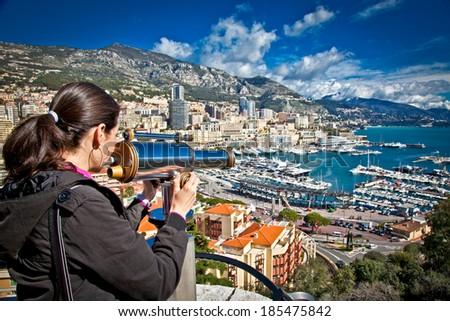 Beautiful woman looking at  Monte Carlo harbour in Monaco. Azur coast. - stock photo