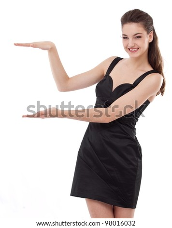 Beautiful woman looking at your product with great joy. Isolated on white background. - stock photo