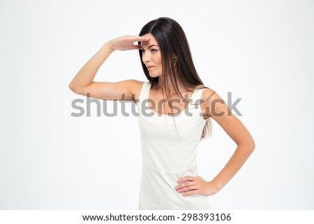 Beautiful woman looking into the distance isolated on a white background - stock photo