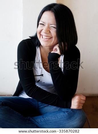 Beautiful woman looking through a window. - stock photo