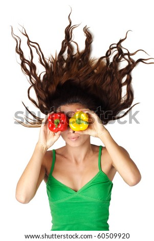 Beautiful woman lying and hold peppers near eyes and hair is dishevelled isolated - stock photo
