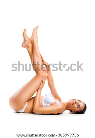 Beautiful woman lying on her back, isolated on white background  - stock photo