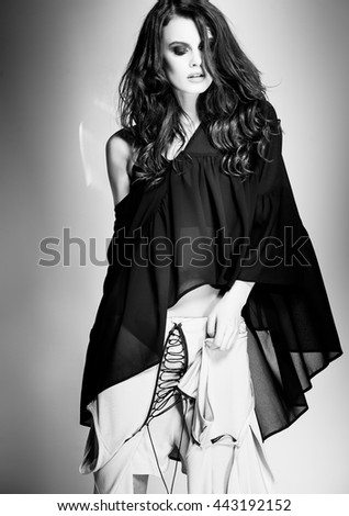 beautiful woman model model dressed in black summer clothes - stock photo