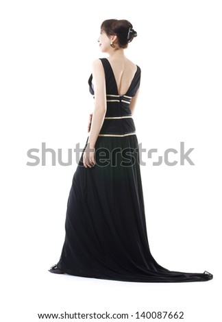beautiful woman model posing in elegant dress back, in the studio - stock photo