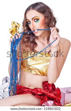 beautiful woman model with bright make-up and decoration beads and gift - stock photo