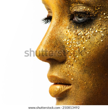 beautiful woman model with professional makeup, golden face - stock photo