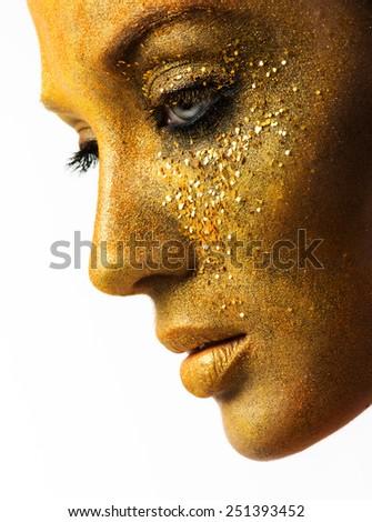 beautiful woman model with professional makeup, golden face - stock photo