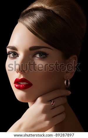 Beautiful woman model with retro hairstyle and bright make-up. Accessories, jewelry gold ring and earrings with ruby. Alluring vintage romantic style, chic makeup and luxury jewellery - stock photo
