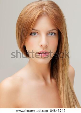 beautiful woman naked shoulders looking at camera - stock photo