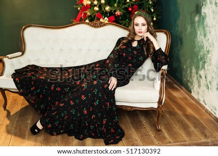 Beautiful woman near christmas tree