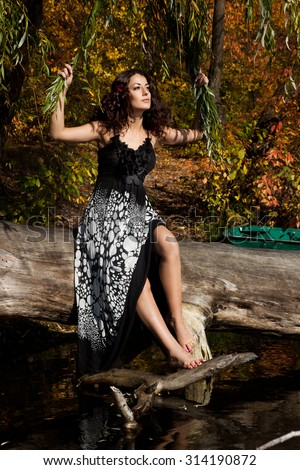 beautiful woman near the river - stock photo