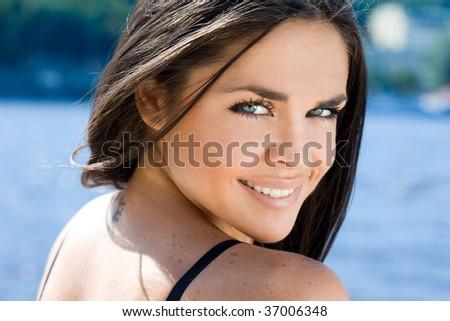 beautiful woman near the sea - stock photo
