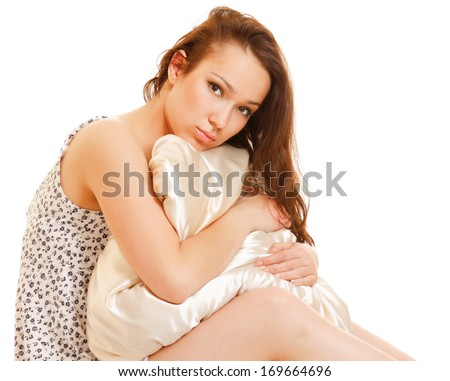 Beautiful woman on a bed and pillow - stock photo