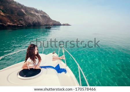 beautiful woman on a boat - stock photo