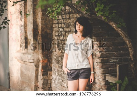 Beautiful woman on a city street. Outdoor portrait of attractive teen girl, warm toned. Outdoor color fashion sensual portrait of young beautiful woman - stock photo