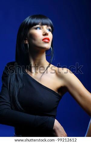 Beautiful woman on a dark blue - stock photo