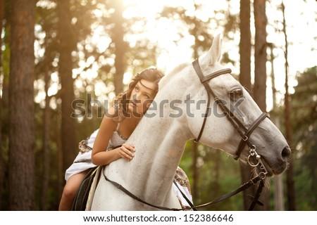 Beautiful woman on a horse. Horseback rider, woman riding horse - stock photo