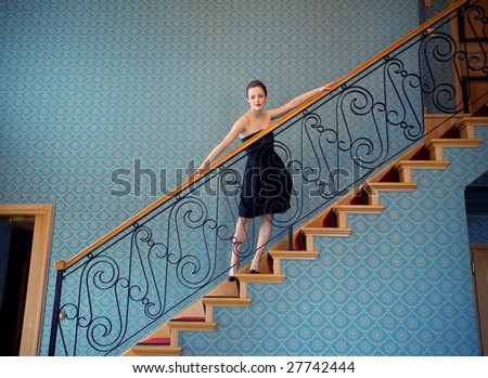 Beautiful woman on a stairs - stock photo