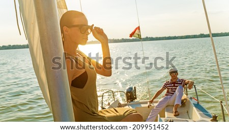 Beautiful woman on a yacht at summer. - stock photo