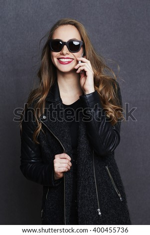 Beautiful woman on phone in studio, smiling
