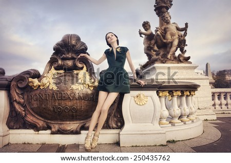 Beautiful woman on Pont Alexandre at dawn, in Paris, France. - stock photo