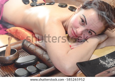 beautiful woman on stone massage
