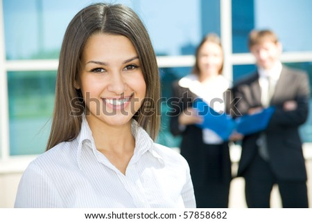 Beautiful woman on the background of business people - stock photo