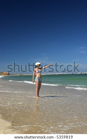 Beautiful woman on the beach showing some interesting