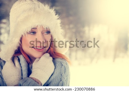 Beautiful woman on the winter scenery - vintage style - stock photo