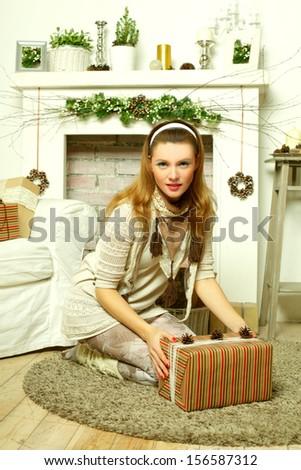 Beautiful woman open Christmas gift box - stock photo