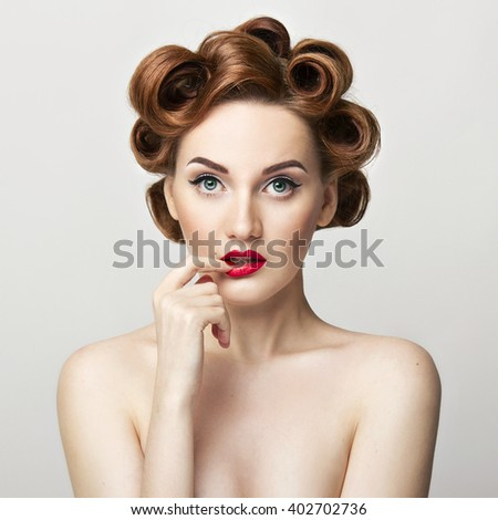 Beautiful woman pinup style portrait. Perfect manicure, makeup and hair.  - stock photo