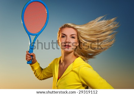 Beautiful woman playing tennis - stock photo