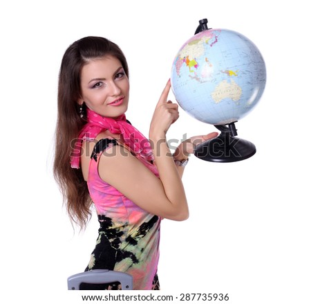 Beautiful woman pointing at the globe where it wants to go.