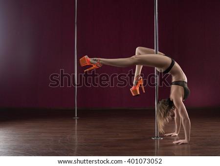 Beautiful woman pole dance - stock photo