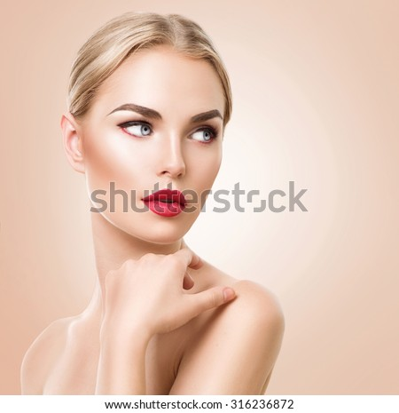 Beautiful woman portrait. Beauty Spa woman  with perfect fresh skin and perfect makeup. Pure Beauty blonde model girl over beige background. Youth and Skin Care Concept - stock photo