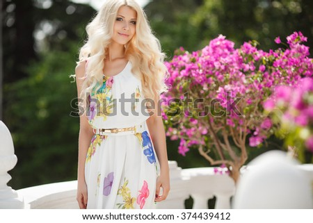 beautiful woman portrait. blonde girl in blooming garden. bride. beautiful cute tender young blonde girl in the rose garden. Woman in spring park.Outdoor portrait.  - stock photo