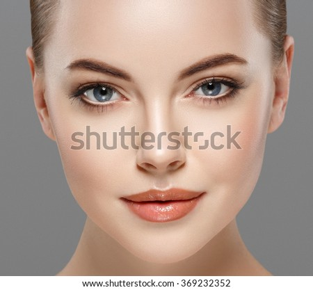 Beautiful woman portrait close up face studio isolated on gray  - stock photo