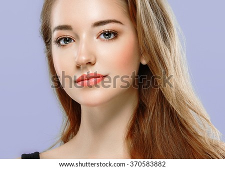 Beautiful woman portrait face studio on color background - stock photo