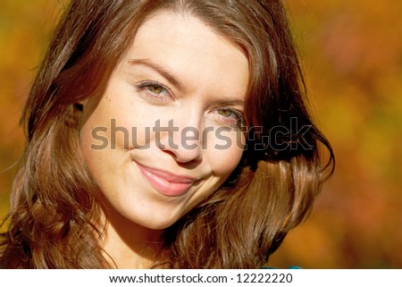 beautiful woman portrait in her thirties smiling outdoors - stock photo