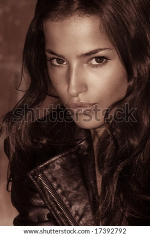 beautiful woman portrait in leather jacket, outside - stock photo