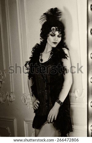 Beautiful  woman, portrait in retro flapper style .  Old photo. Vintage toning. - stock photo