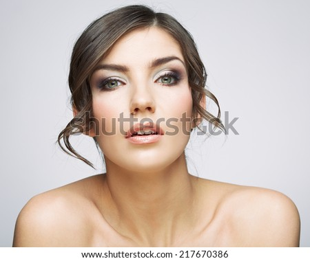 Beautiful woman portrait . Nude shoulders. Female model studio posing. - stock photo