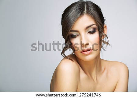 Beautiful woman portrait . Nude shoulders. Female model studio posing. - stock photo