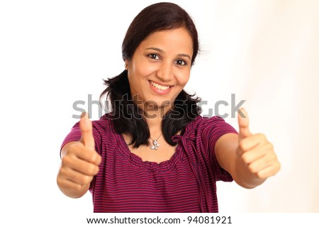 Beautiful woman portrait showing thumbs up - stock photo