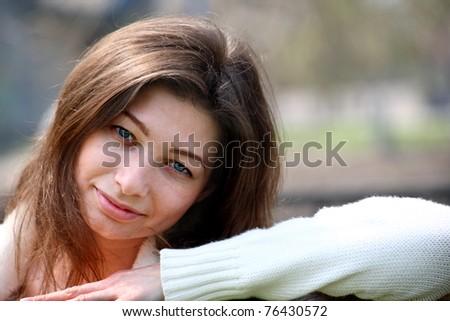 Beautiful woman portrait smiling outdoors - stock photo